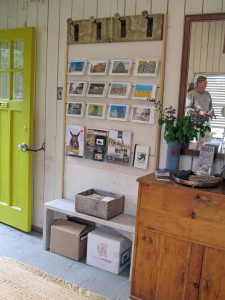 Greeting cards with farm images and popular farm magazines are displayed just inside the door.