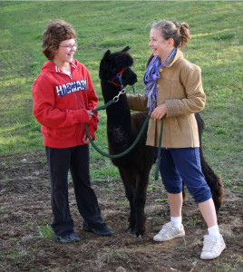 Every friend who visits gets a guided tour of the barn and a walk with the alpacas.